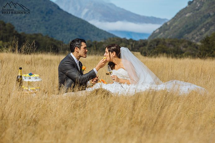 Bride and Groom share cake and champange during  Queenstown wedding