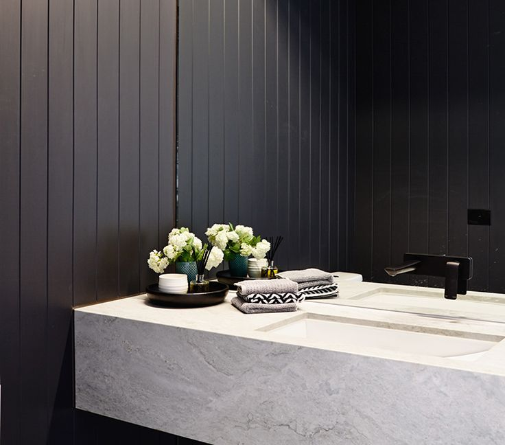 Black panelled wall//thick marble vanity. Lubelso-Bathroom: