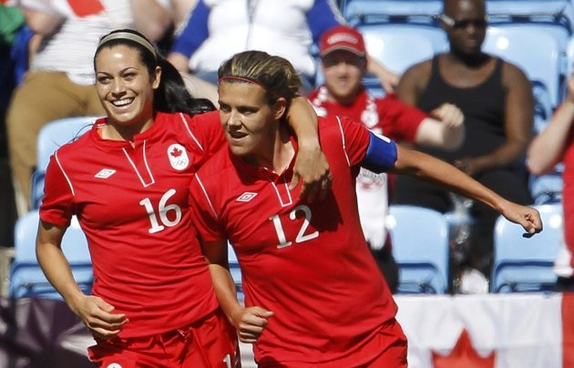 Canada's Christine Sinclair (R) celebrates with her team mate Jonelle Filigno after scoring a goal against South Africa during their women's Group F football match at the London 2012 Olympic Games in the City of Coventry Stadium July 28, 2012