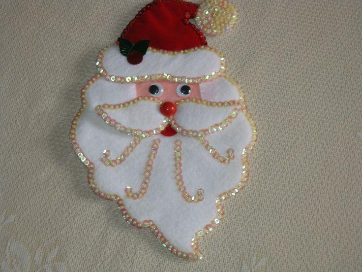 Linda carita de Papa Noel confeccionada en paño lency y lentejuelas...
