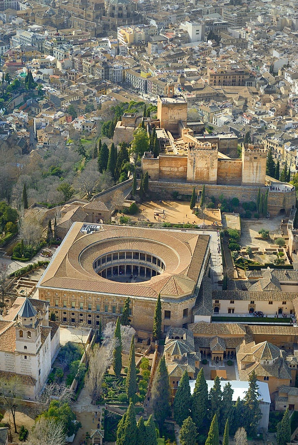 The Alhambra clearly showing the Christian palace of Isabel and Ferdinand with it's square exterior and round centre. Today this houses a museum.