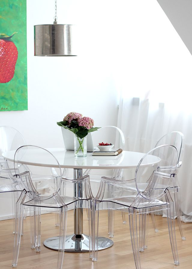 dining area in all white + louis ghost chairs