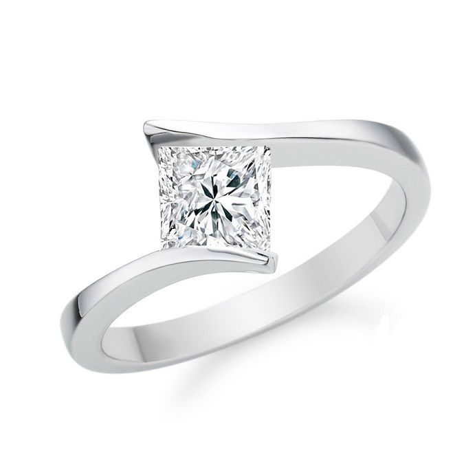 """Marika"" CROSSOVER PRINCESS DIAMOND SOLITAIRE RING Modern princess cut diamond solitaire engagement ring tension set between tapering solid shoulders within a crossover design."