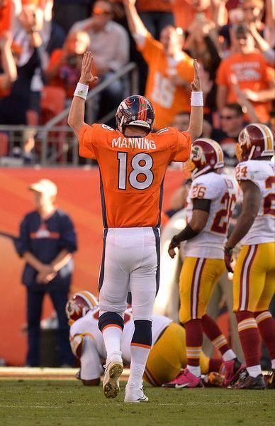 Denver Broncos quarterback Peyton Manning (18) signals for a touchdown after Denver Broncos running back Montee Ball (28) ran it in during t...   #ProFootballDenverBroncos