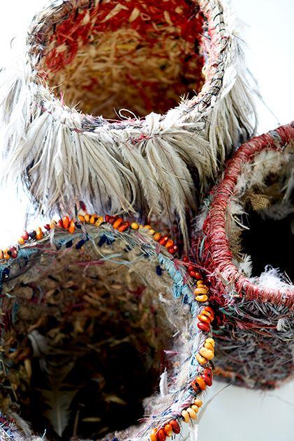 Tjanpi Desert Weavers: Nyinku Kulitja and Wipana Jimmy, 2008, carded wool, raffia, wire, feathers and ininti seed. Tjanpi Desert Weavers is a not-for-profit Aboriginal social enterprise established in 1995 by the Ngaanyatjarra Pitjantjatjara Yankunytjatjara Women's Council to provide an income source for women living in remote Central Australian communities.