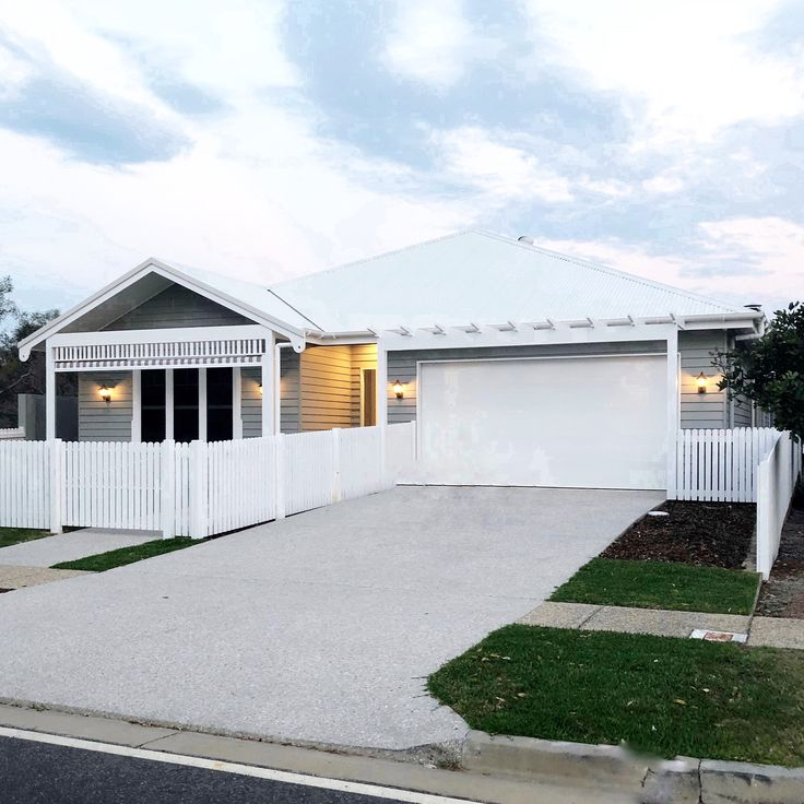 Traditional white picket fence was a must for this house along with traditional windows and some dance fretwork. @the_beach_lounge