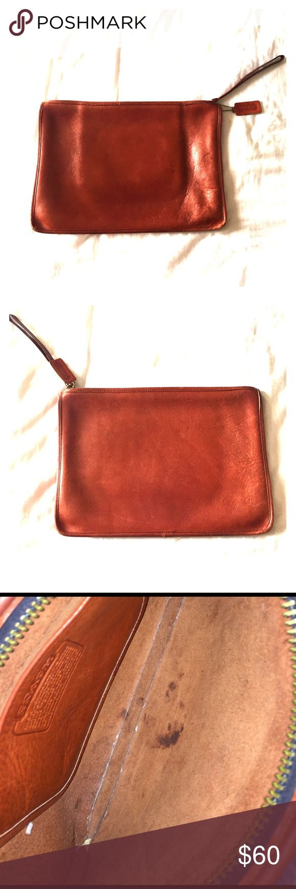 COACH brown clutch COACH leather clutch bag. Just about bigger than the size of an iPad. Slight stains on the inside, price reflected. Otherwise in great condition. Coach Bags
