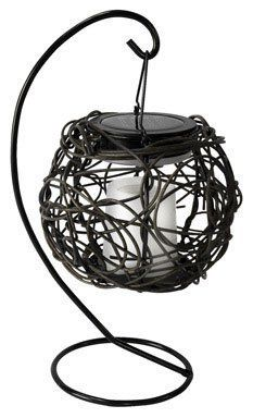 "Paradise Garden Tabletop Grapevine Basket Solar Light *Dark Brown by Paradise Garden. $16.99. Flickers like a real candle. Durable plastic/vinyl material in a grapevine design. Dark brown. Weather resistant making it ideal for outdoor use. ""PARADISE GARDEN"" TABLETOP GRAPEVINE BASKET SOLAR LIGHT. ""PARADISE GARDEN"" TABLETOP GRAPEVINE BASKET SOLAR LIGHT         Dark brown     Durable plastic/vinyl material in a grapevine design     Weather resistant making it ideal f..."