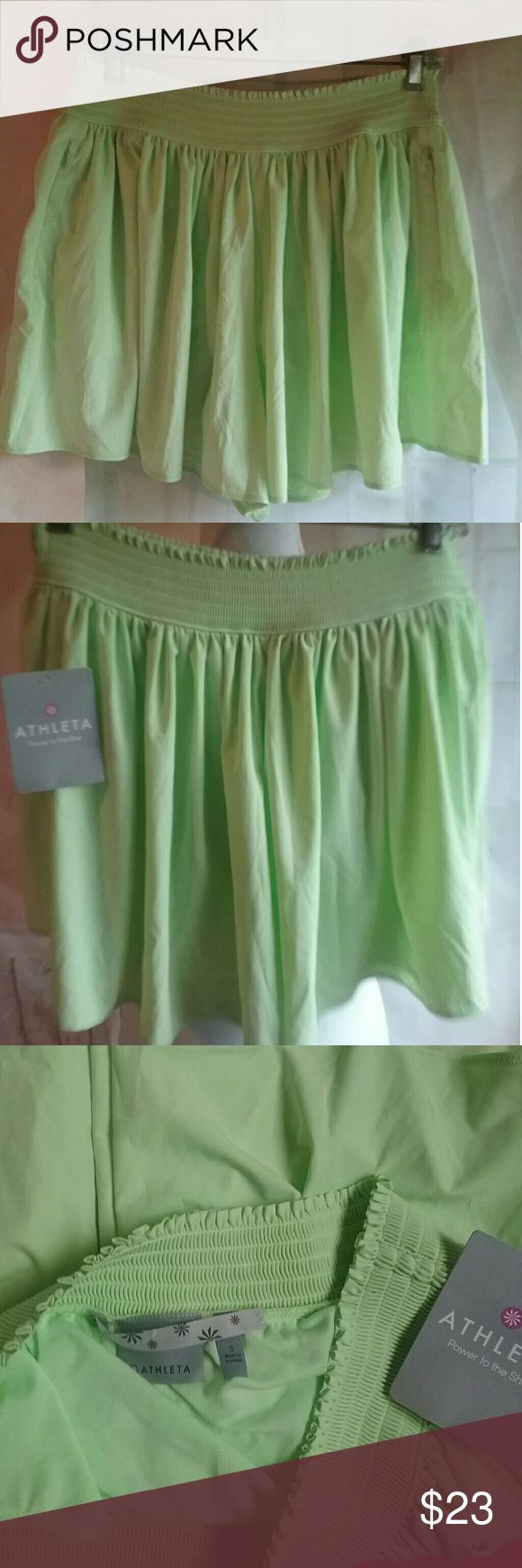 Athletta Lime Green Sneaky Short New $49 This is Athletta  lime-green sneaky short. It is new with tags. Suggested manufactured retail price is $49. Great color for spring to Summer. athletta  Shorts Skorts