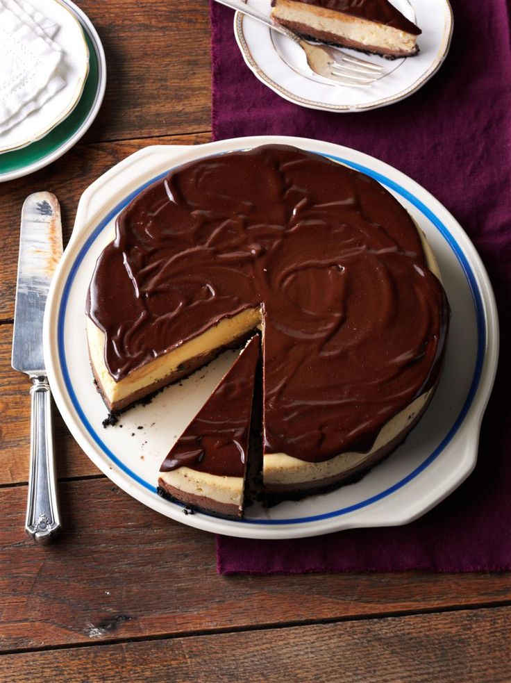 "Mudslide Cheesecake Recipe -Change up cheesecakes with different liqueur flavorings. This ""mudslide"" version with coffee and Irish cream is my husband's favorite. —Sue Gronholz, Beaver Dam, Wisconsin"