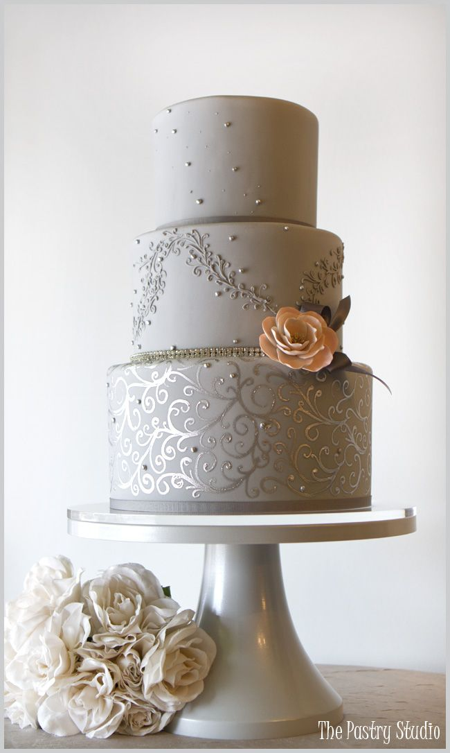 A Chic Gray and Silver Wedding Cake accented      add a blue flower