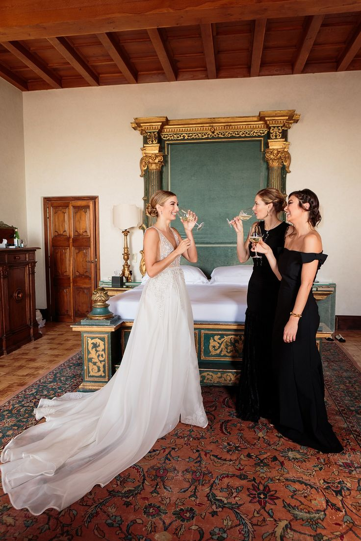A toast in my room before heading to the church. In a break from European wedding etiquette, I had my bridesmaids choose black gowns that suited them. Eaddy is in Elie Saab and Chloé is in La Petite Robe di Chiara Boni.