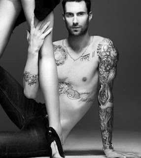 Am I the only one who finds arm tattoos on guys really sexy???  (Especially The Sexy Adam Levine)