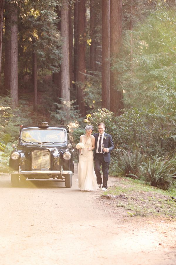 Wedding portrait by a vintage taxi. Photo by Kate Harrison