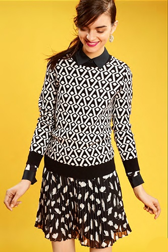 Graphics on graphics? Done. Mix two bold black-and-white prints for double the impact.