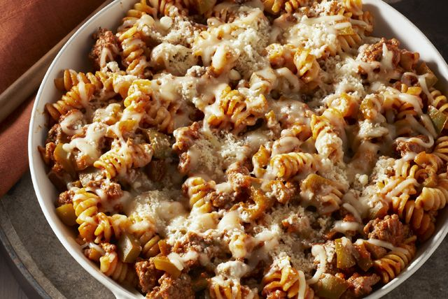Make any weeknight special with this 30-minute skillet made with ground beef, rotini pasta, spaghetti sauce and two kinds of cheese.