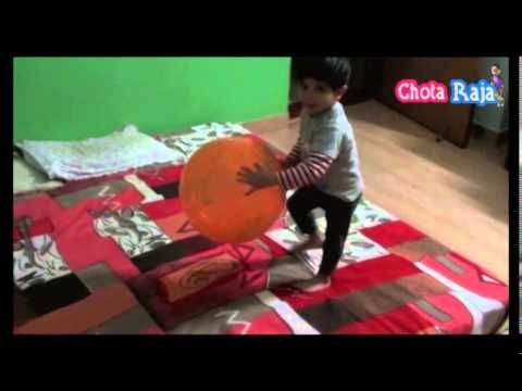 Chota Raja kid Playing with Balloon on Bed.