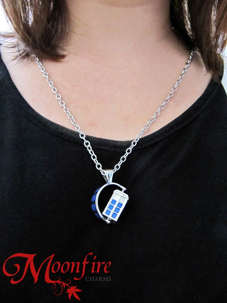 Inspired by Doctor Who, this 3-dimensional TARDIS police box is set on an axis and rotates! Now you can travel through time and space in style! The silver-plated pendant measures 2 cm in height and 2