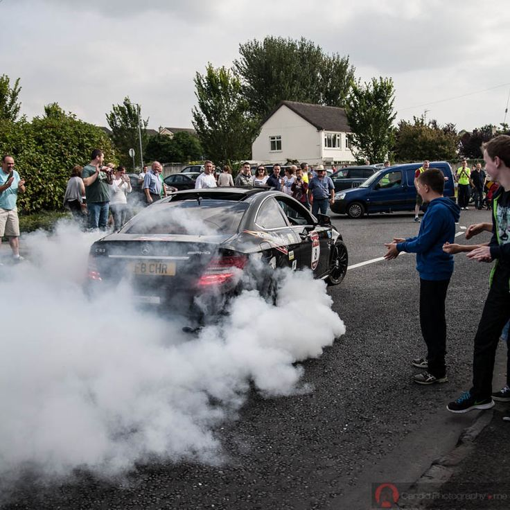 Car does a burn off for the crowd at Cannonball 2014