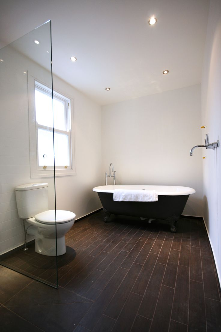 Traditional bathroom / wet room with roll top bath.  For a free consultation call: 0113 262 5954 http://www.redesignexperts.co.uk/