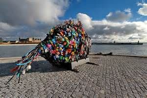 the plastic fish overlooking the ocean and Sweden