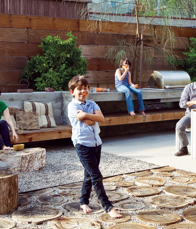 The first thing landscape designer Laura Cooper asked Devis and Purdy was to recall childhood gardens and outdoor play. In that spirit, s...