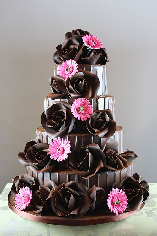 Beautiful Chocolate wedding cake with chocolate roses - amazing.. w purple