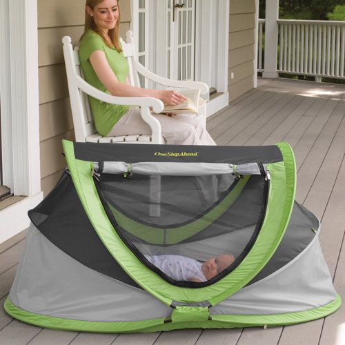 Boy, I could have really used this today while we were in the courtyard.  It was sunny and windy so the baby would have been protected while I watched my toddler play.  I could also use this on the beach, or for sleepovers at Grandma's for the holidays!  PeaPod Plus Baby Travel Bed