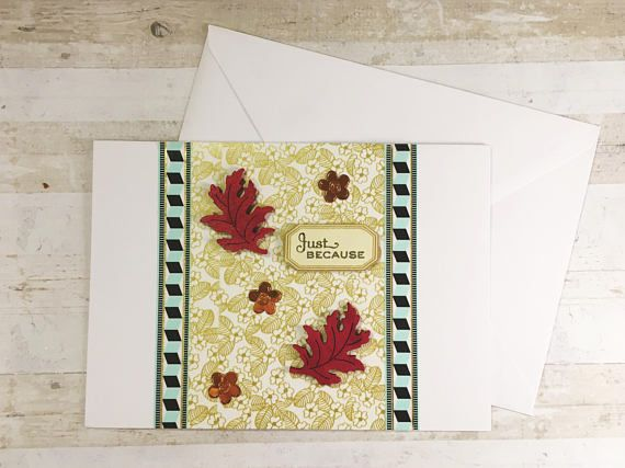 Because why not send a card? This autumn, send a card just because you can. Two red wooden leaves, three golden flowers, and the Just Because greeting against a lovely flowery background. A modernistic Turquoise border runs either side. Each card is uniquely handmade, with the