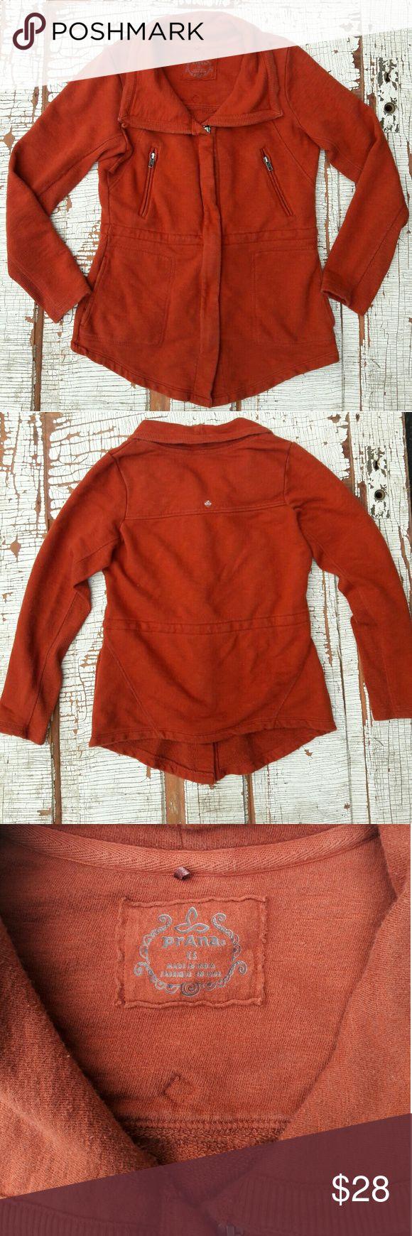 "Prana orange zip up sweatshirt xs Burnt orange Prana zip sweatshirt jacket with 2 zippered pockets and 2 open pockets. A drawstring on the inside of this sweatshirt can give the wearer an extra flattering look  Shoulders- 15"" Bust-18"" Length- 24"" Arm Inseam-18"" Prana Tops Sweatshirts & Hoodies"