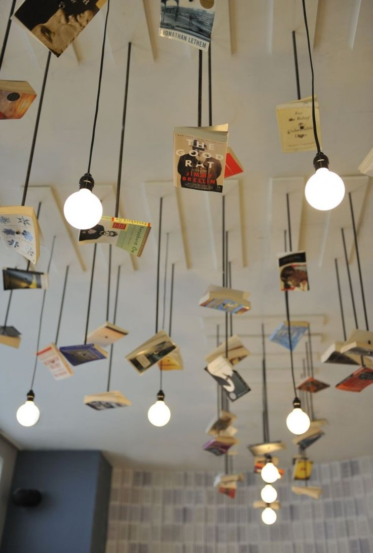 Books with bulbs :)  McNally Jackson Bookstore Cafe designed by Front Studio  www.frontstudio.com