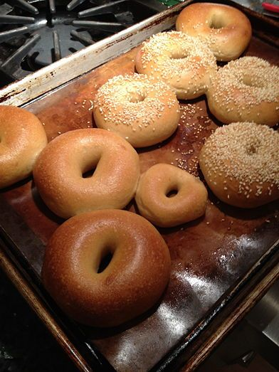 Topped and un-topped bagels after the baking stage (notice the small leftover sample bagel - my daughter's favorite!)