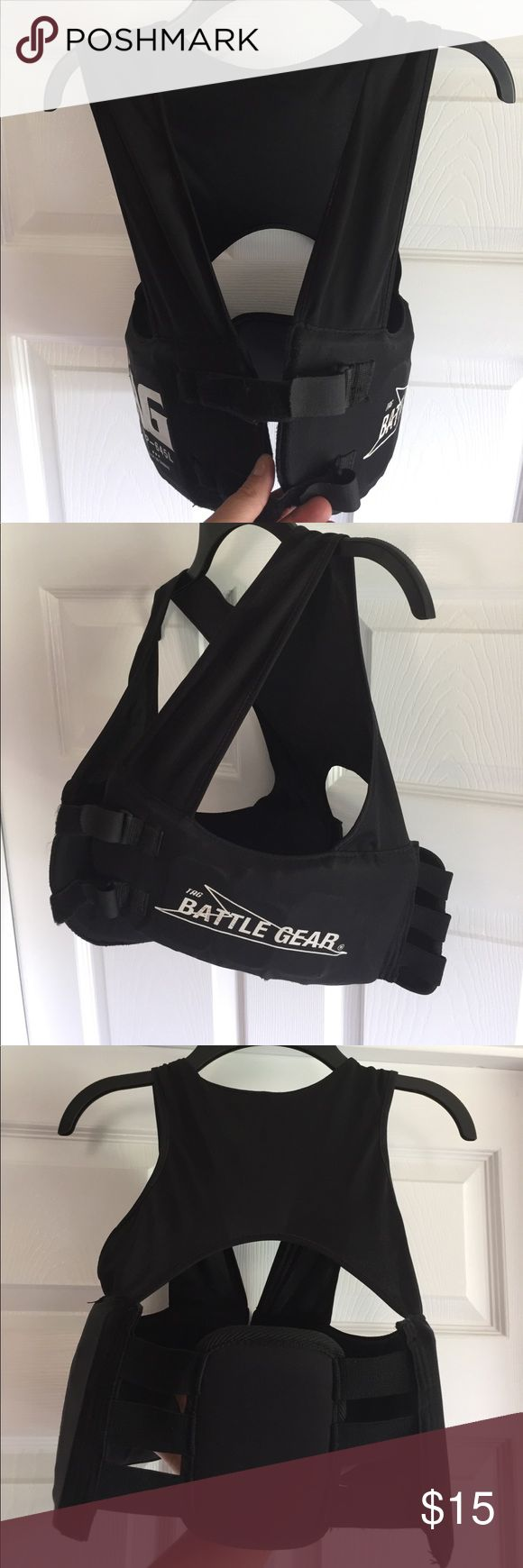 🏈Football Rib Protector Vest Tag Battle Gear Rob Protector Vest. Has normal signs of use after playing football 3yrs. My son was QB in high school and my husband bought this for those rough QB sacks at times. Still has some life to it and works great. As shown in last 2 pics has some tears and can probably be sewn. Accessories