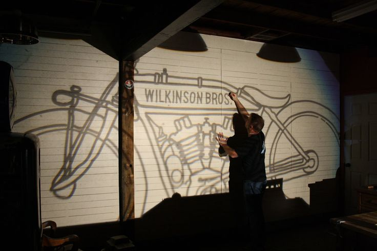 Old-school overhead projector casts our drawing for a motorcycle mural.