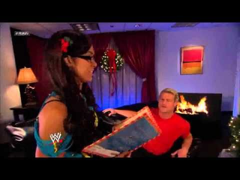 AJ Lee and Dolph Ziggler Kiss under the Mistletoe