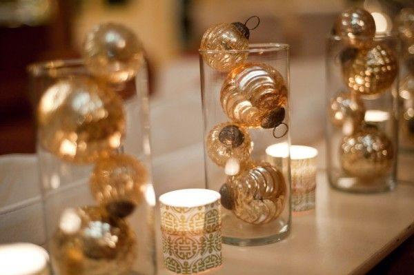 simple and doesn't look expensive! we can just use gold plastic balls and not Christmas ornaments  Table accents with cylinder vases and gold ornaments.  Mix and match with gold shredding in vases. (The Sweetest Occasion)