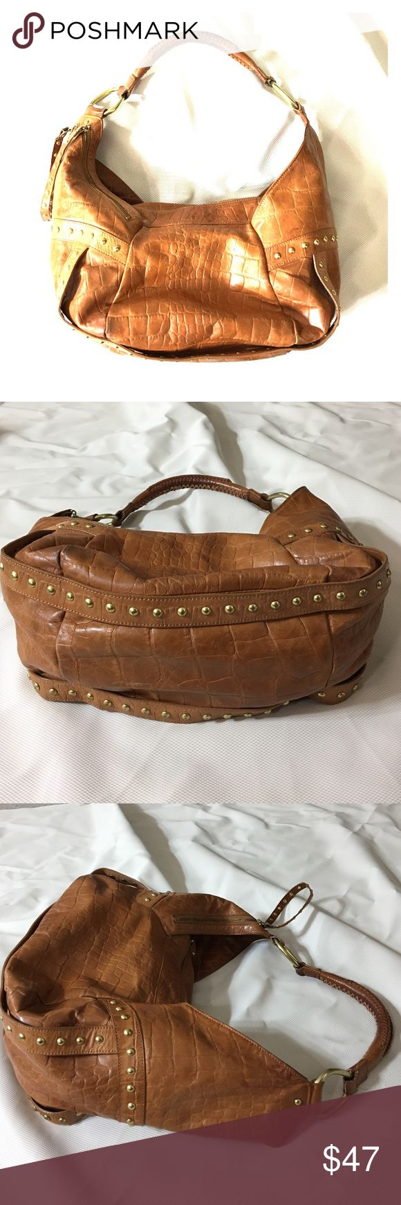 Kenneth Cole tan gold leather hobo  large purse Kenneth cole leather and gold purse large size very nice with an outside compartment for a cell phone or wallet two small compartments inside and one zippered compartment with a keychain very nice bag very well-made non-smoking home fast still livery at an excellent price get it today Kenneth Cole Bags Hobos