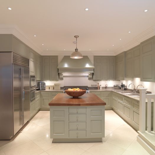 This light and airy kitchen was painted in a Farrow and Ball green.