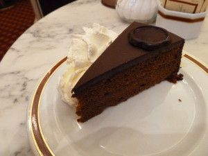 The Hotel Sacher is a grand old property in Vienna's first district. The ground floor café has marble topped tables and red upholstery and the wait-staff are attired in black with white aprons. There's a conservatory that faces the street and in the summer time, it's transformed into open air...