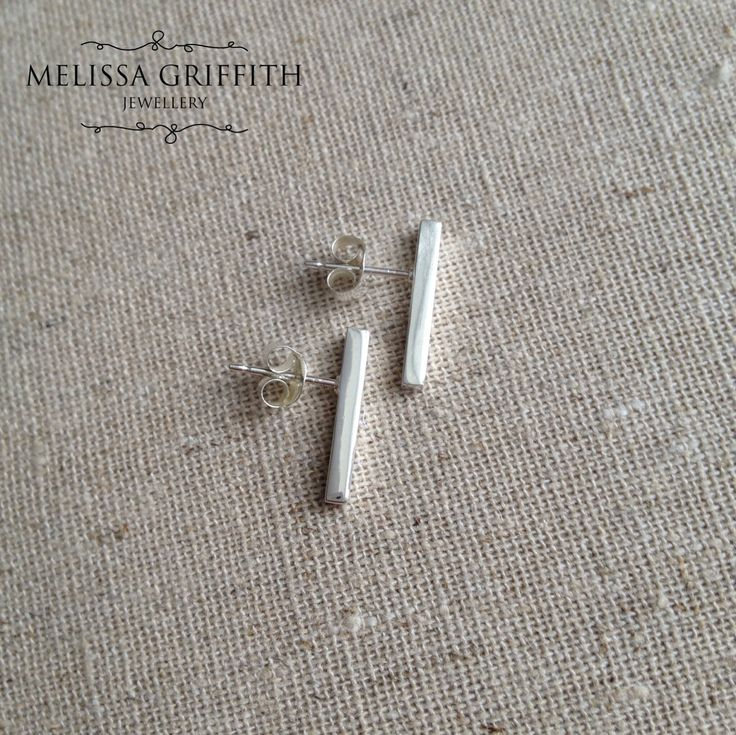 Bar Post Earrings (MGE98) $34.00 Simple and sleek post earrings with clean and structural lines. These sterling silver earrings are perfect for everyday, and will add just the right touch of sparkle to your look! Bar measures 15x2mm.