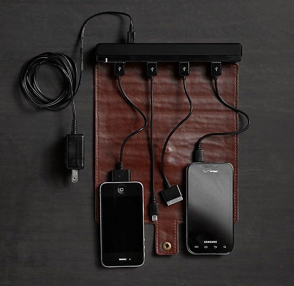 Restoration Hardware Roll-Up Travel Charger. It's a hassle to rotate through your devices because you're stuck with one charger—or one outlet—while on the road. This efficient roll-up leather charging station allows you to juice up four devices simultaneously using just one outlet