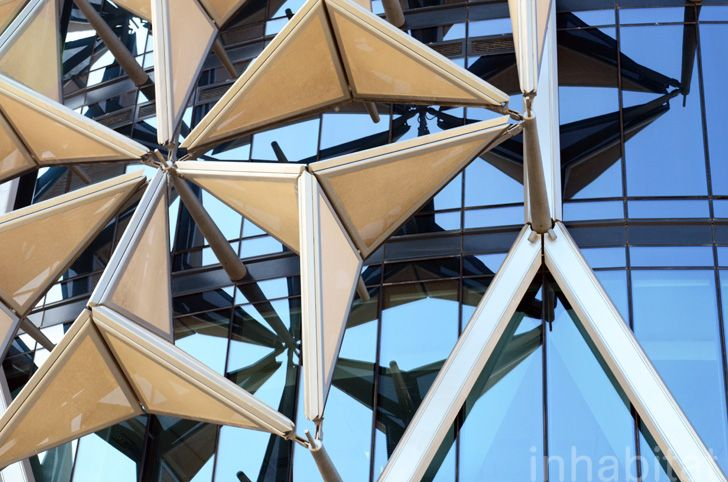 Inhabitat toured the award-winning Al Bahr towers designed by Aedas Architects in Abu Dhabi; they are shaded with the world's largest computerized façade.