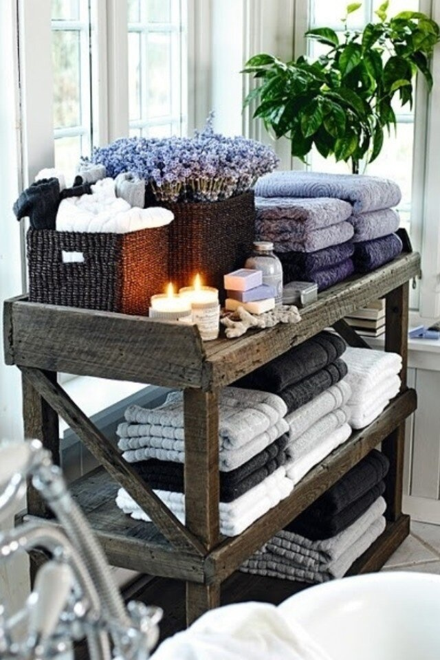 Re-paint shelf in bathroom, get pretty baskets to hide mismatched towels
