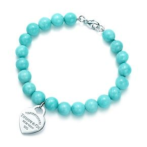 Return to Tiffany™ small heart tag in silver on an amazonite bead bracelet.
