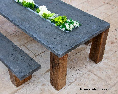 """precast concrete tabletops & recycled timber salvaged from Kentucky barns"" ... I like the idea of a built-in planter that serves as a permanent centerpiece-!"