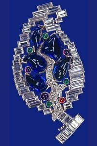Sapphire, diamond, emerald, amethyst and ruby brooch - given be Duke of York (future George VI) to Duchess of York (future Queen Elizabeth, later The Queen Mother) in 1928 and to Princess Elizabeth by her parents as a birthday present during the Second World War.