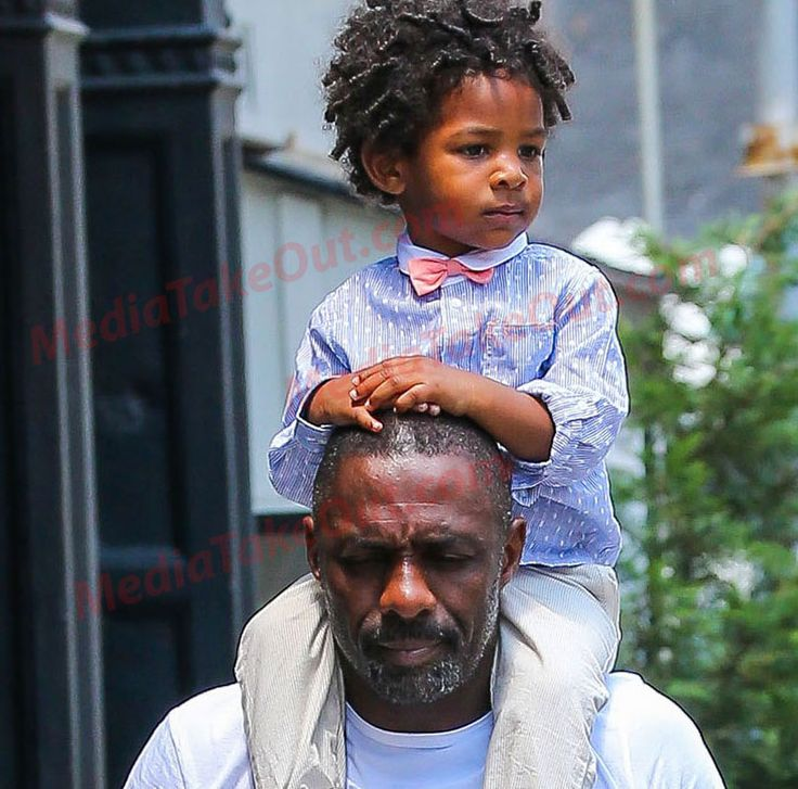 Idris Elba and his son Winston were spotted out with a friend in New York City on July 6. Winston got a little tired of walking so his daddy gave him a ride on his shoulders. Little Winston got that preppy J Crew look. Idris and his girlfriend Naiyana Garth welcomed their first child together …