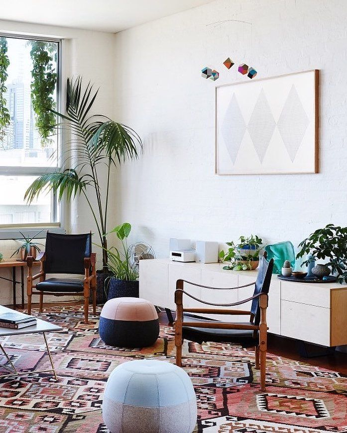The Roy coffee table & Puku ottomans in old apartment shot by Sean Fennessy for The Design Files
