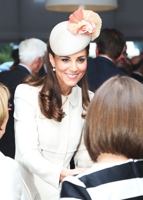 Catherine, Duchess of Cambridge speaks to guests after a ceremony at St Symphorien Military Cemetery on August 4, 2014 in Mons, Belgium. Monday 4th August marks the 100th Anniversary of Great Britain declaring war on Germany