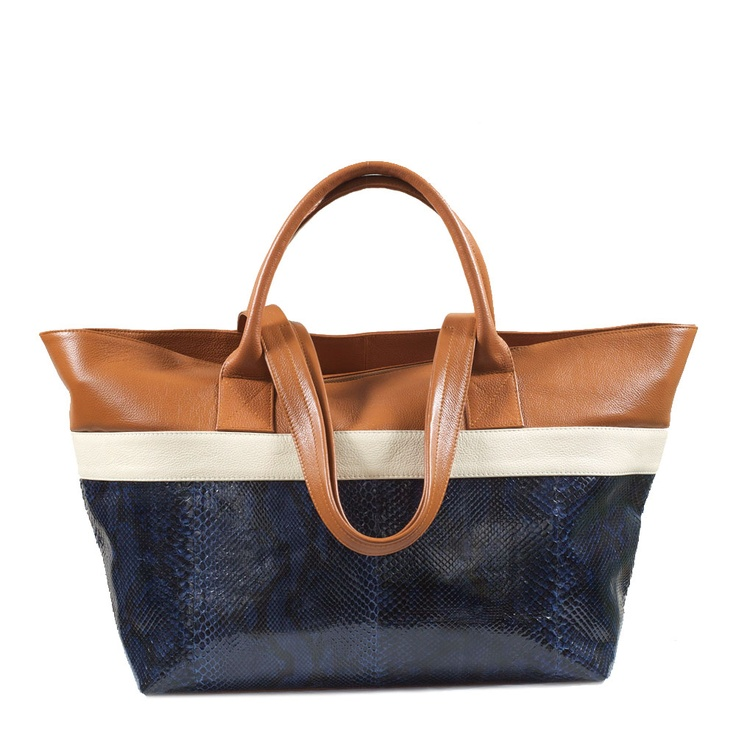 BOLDO Shopper Tote in Navy Python. With a short handle for holding by hand, and a long strap for wearing over the shoulder, this Boldo Shopper Tote is best worn doubled up with a smaller bag on a busy day. Roomy and adaptable, it's excellent for travelling and overnights, or for work and weekends. This Shopper Tote is lined in a faux suede for luxury hand-feel. AU$550